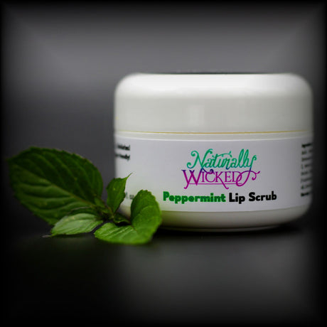 Naturally Wicked Peppermint Sugar Lip Scrub Surrounded By Refreshing Green Peppermint Leaves