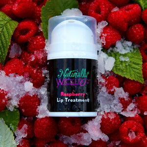 Raspberry Lip Treatment 50ml Lay In A Pile Of Ice & Bright Red Luscious Raspberries With Green Raspberry Leaves