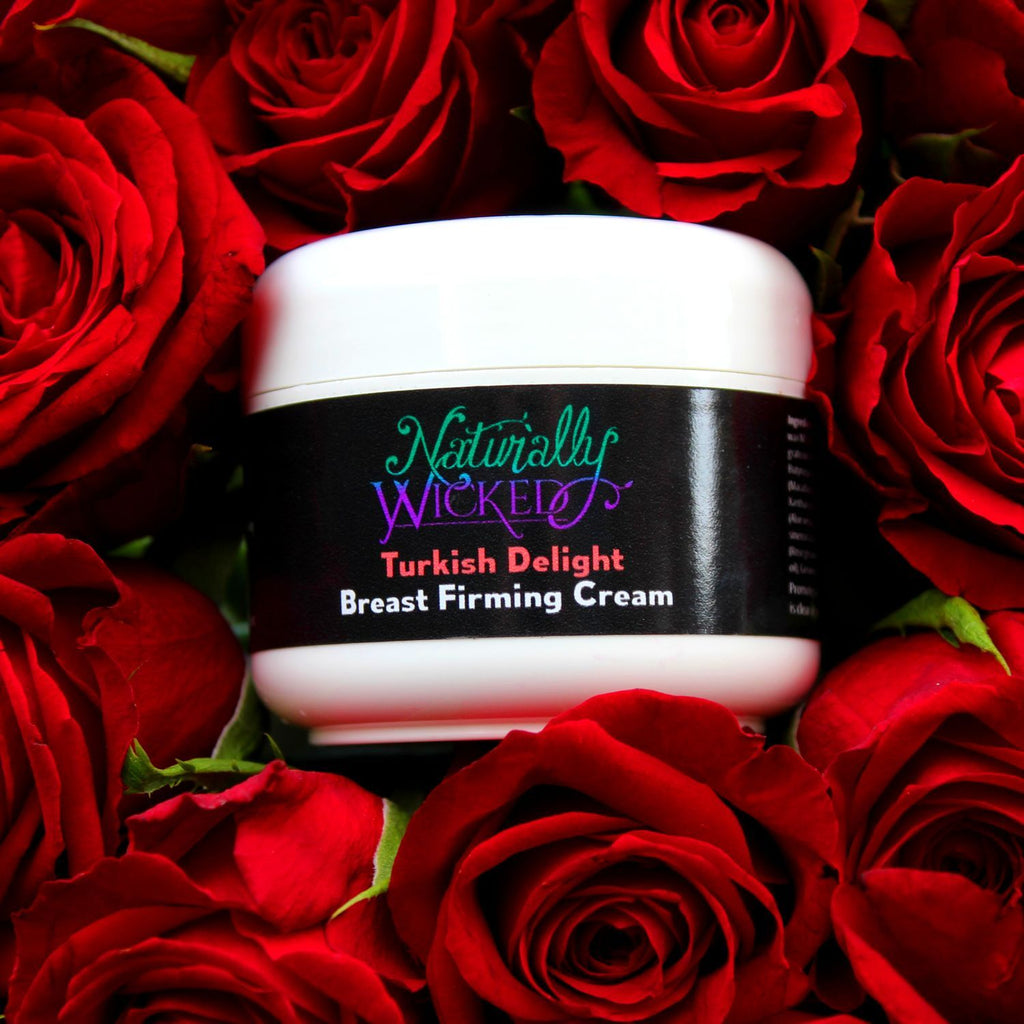Naturally Wicked Turkish Delight Breast Firming Cream Surrounded By Bright Red Roses; An Essential Breast Firming Ingredient