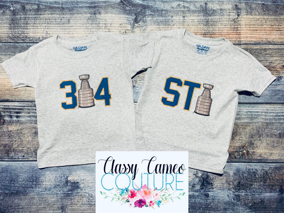 314. STL. Kids & Adults Blues Stanley Cup Tees
