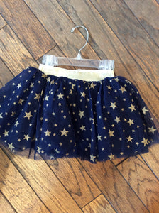 Gold Star Skirt with blue background