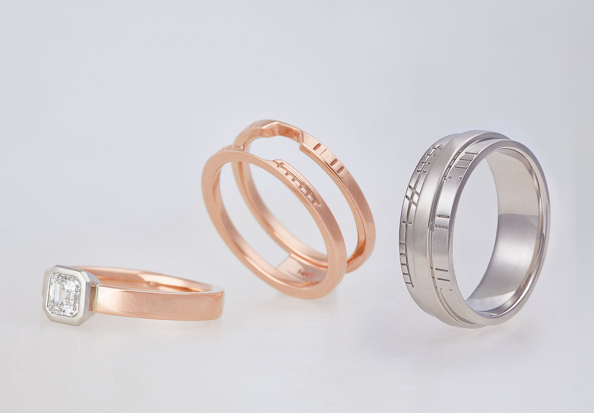 Wedding bands with Mayan numeric symbols and Ogham engraving