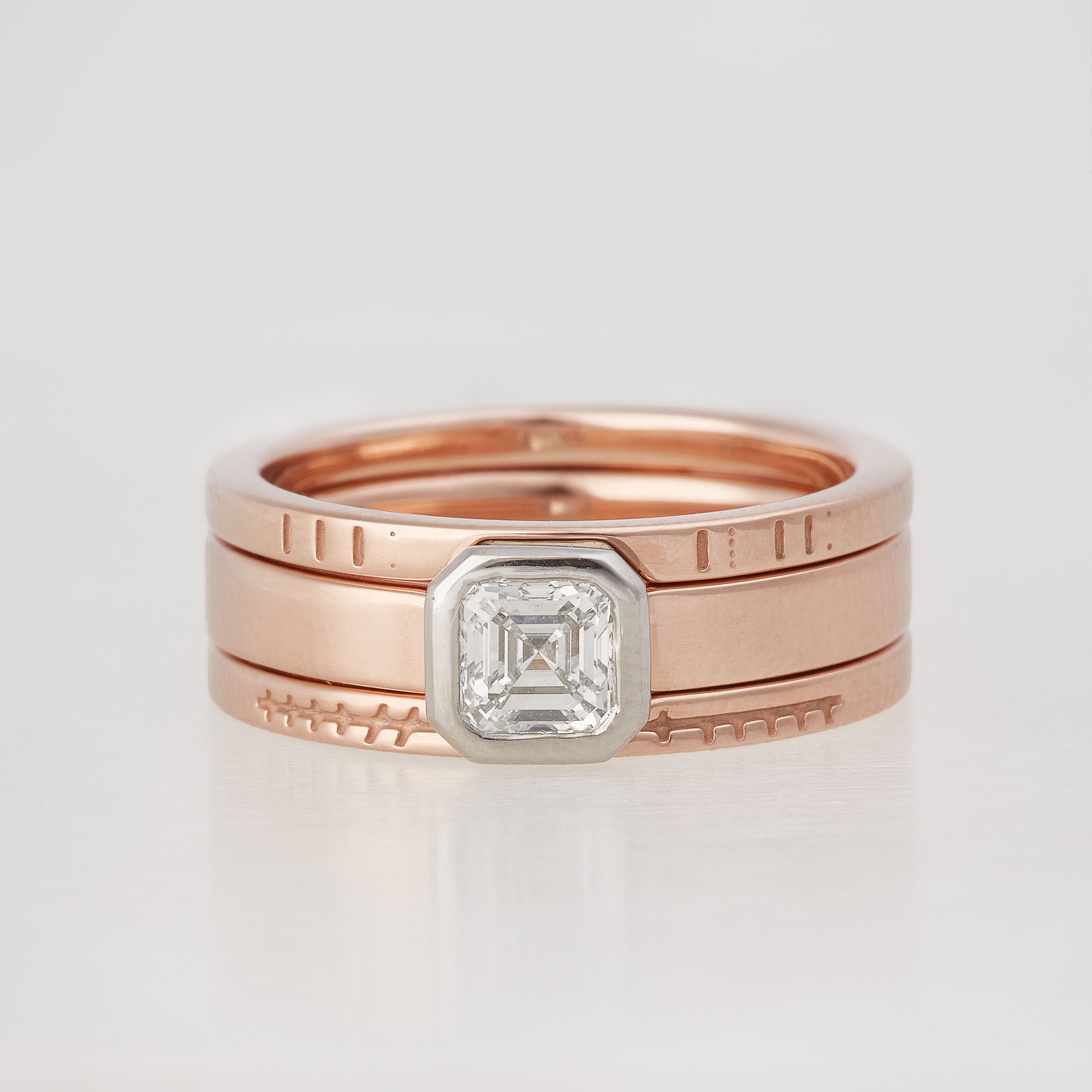 Asscher cut diamond engagement ring in 14K Rose Gold with coordinating wedding band
