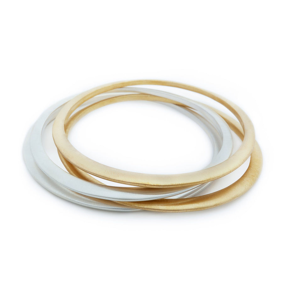 Set of silver and gold minimalist bangles