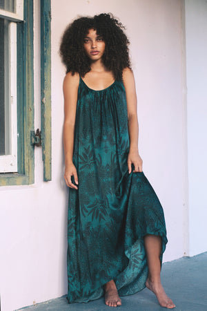 Long Dress in Soul Tree Print. A deep emerald green background with black fern silhouette pattern.