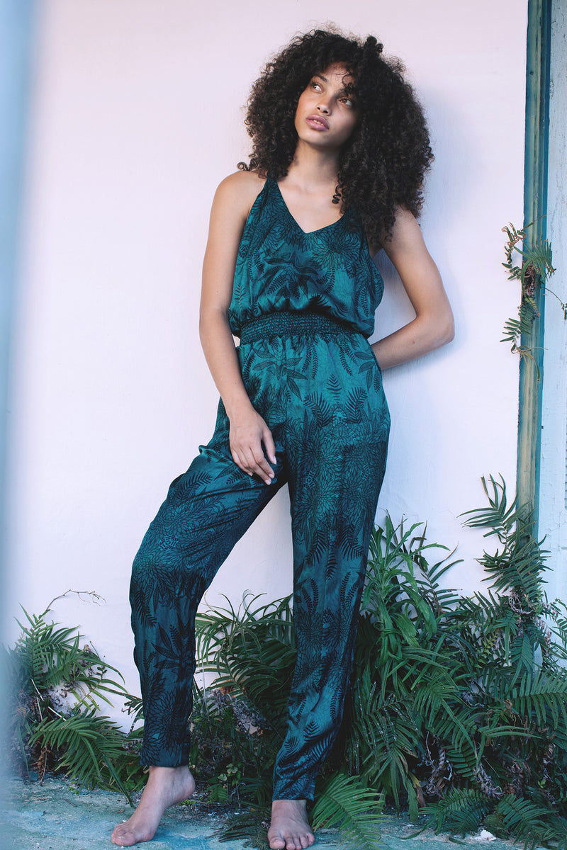 Hamec Bermuda jumpsuit with Tie knot back. Soul Tree Print, deep emerald green background with black fern silhouette