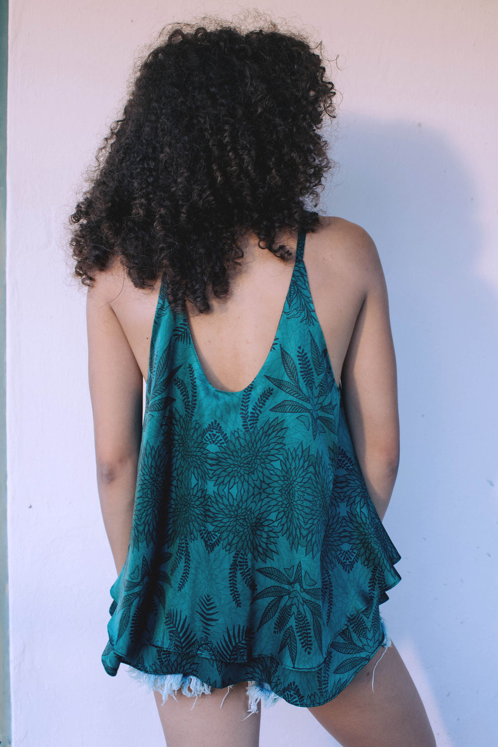 Strap top in Soul Tree Print. A deep emerald green background with black fern silhouette