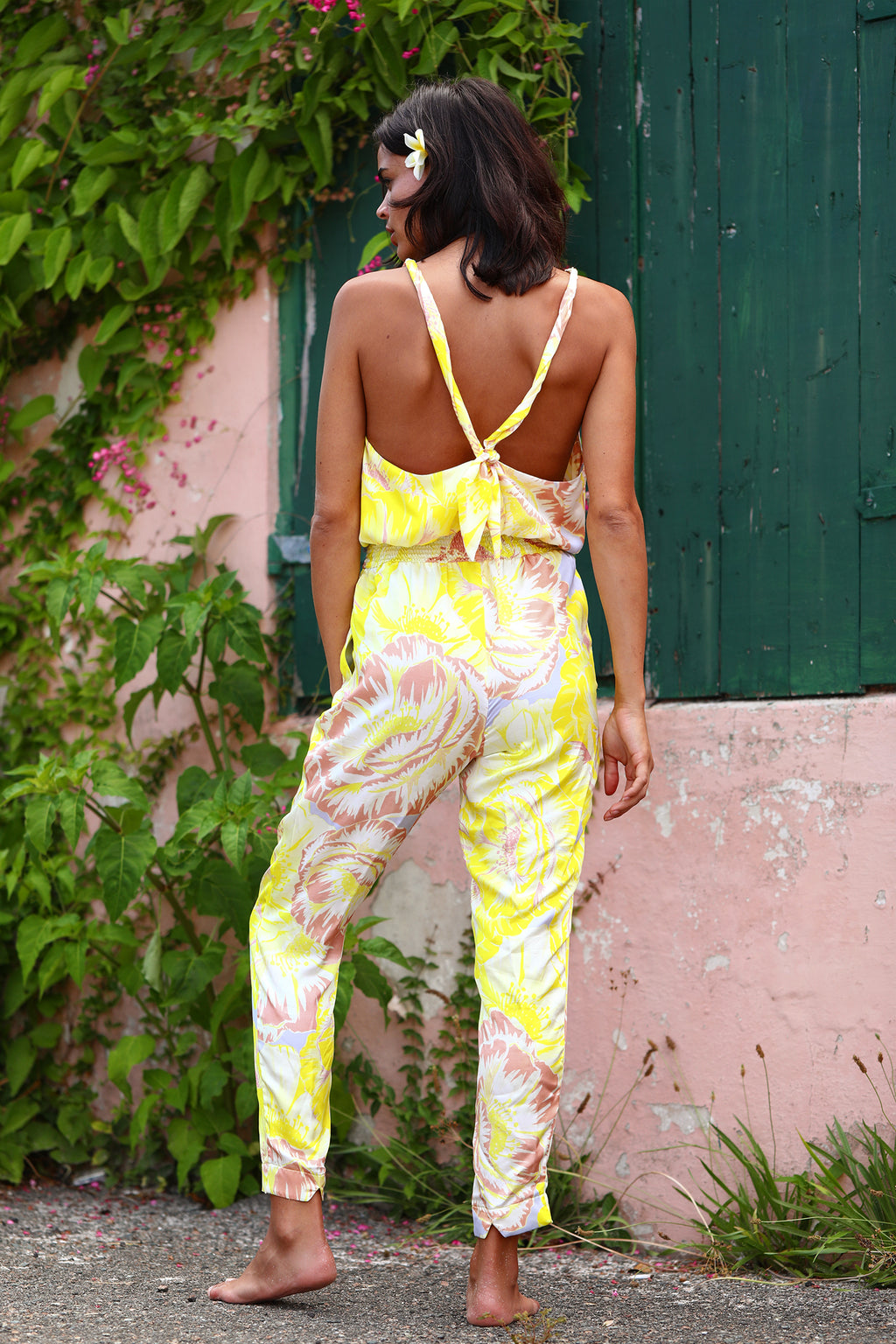 Jumpsuit with tie knot back in Lemom Love You print: bright yellow background with soft blush and white flower pattern.