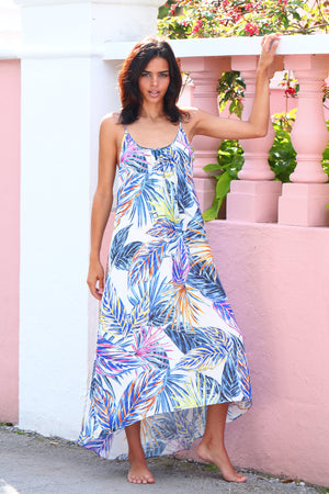 Long Maxi Dress in Hot Steppa print. Vibrant pallet of multi colored palm leaf print on white background.