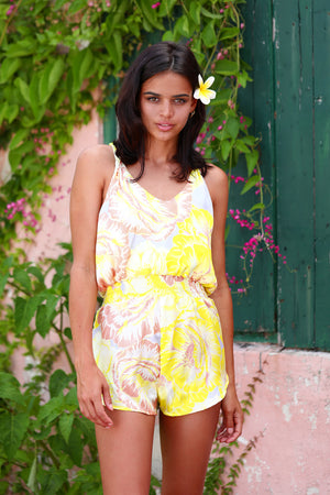 Romper with tie knot back in Lemom Love You print: bright yellow background with soft blush and white flower pattern.