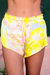 Shorts with tassel tie in Lemom Love You print: bright yellow background with soft blush and white flower pattern.