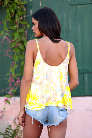 Flowy strap top in Lemom Love You print: bright yellow background with soft blush and white flower pattern.