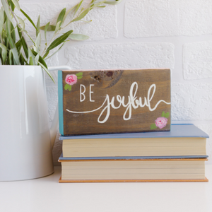 Hand painted wooden block with be joyful quote and small roses