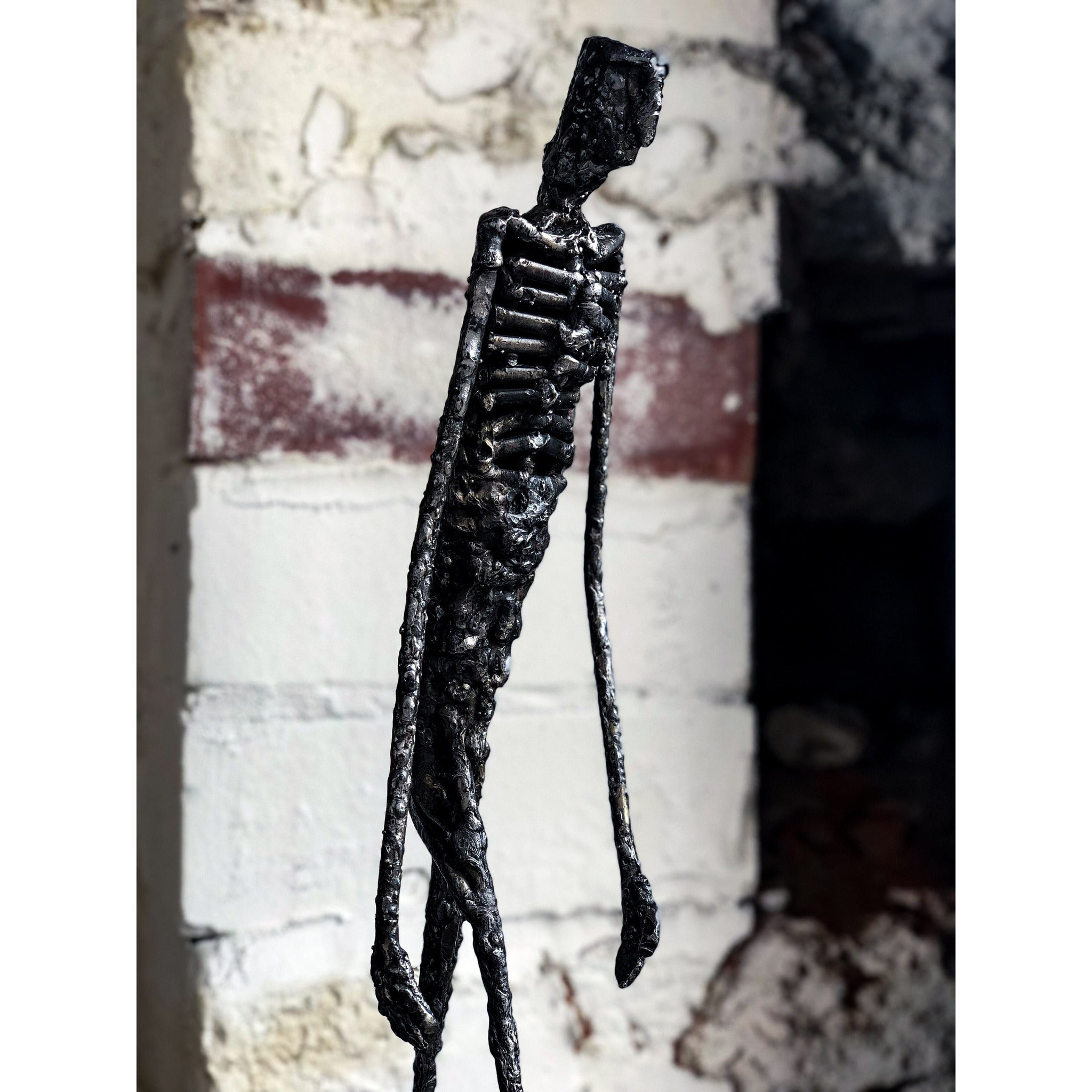 Striding Jaco sculpture by Don Modenbach - Egoiste Gallery