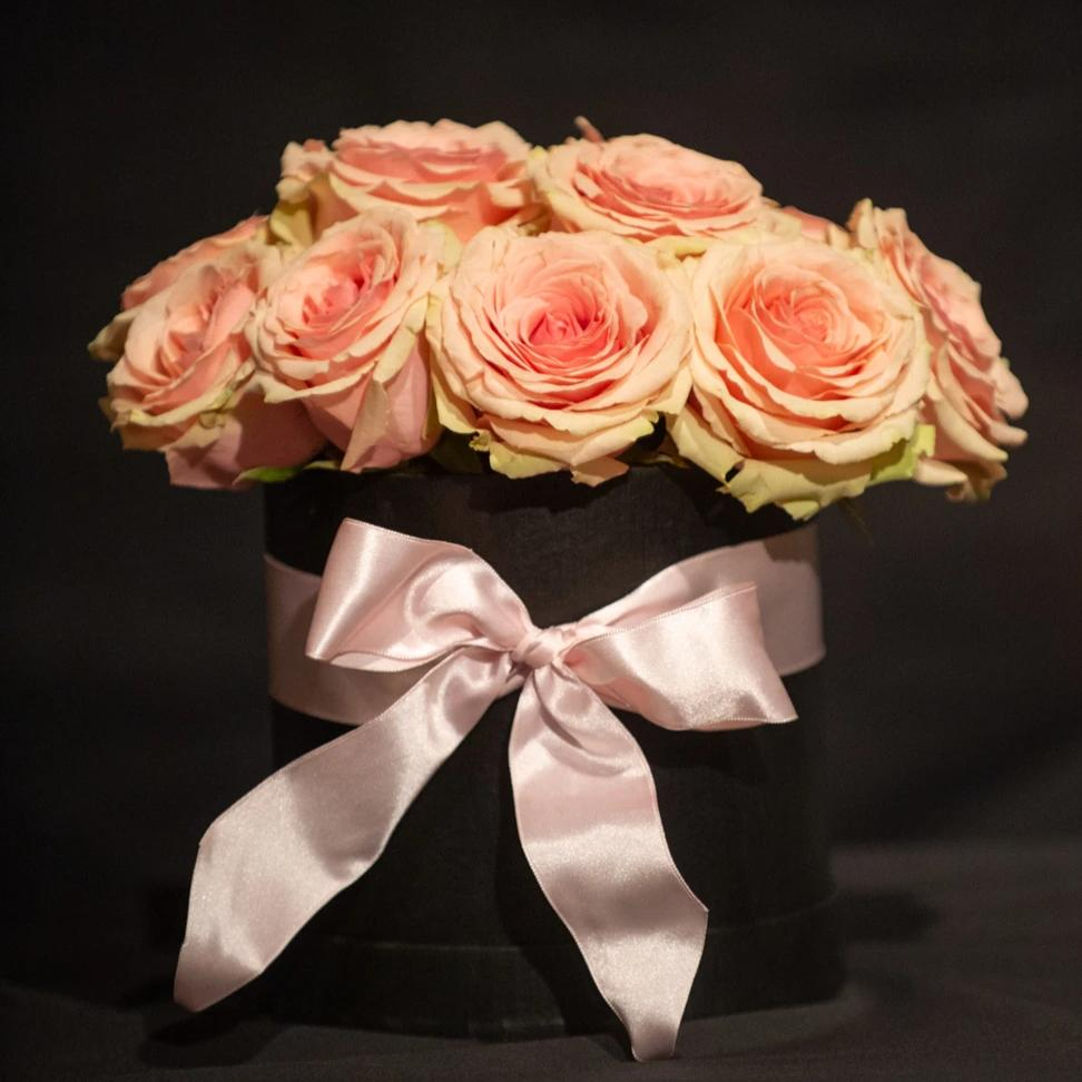 "Flower Bar ""Rose Water"" arrangement is a hatbox container filled with premium roses finished with a box."