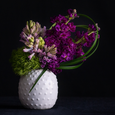 The perfect bedside or desk arrangement of fragrant stock and hyacinth in a white ceramic cactus vessel.