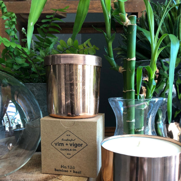 Bamboo & Basil scented candle by vim + vigor. The candle is in a reusable copper candle