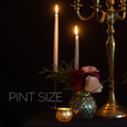 Pint size floral design in gold mercury vase with roses, greenery, and ornament