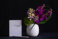 The perfect bedside or desk arrangement of fragrant stock and hyacinth in a white ceramic cactus vessel. Pictured with a standard greeting card for scale
