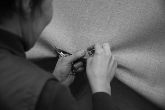 ISE - FETHICAL ACTORY WORKER IN OUR MILL FIXING A FAULT ON OUR ORGANIC BELGIAN LINEN FABRIC