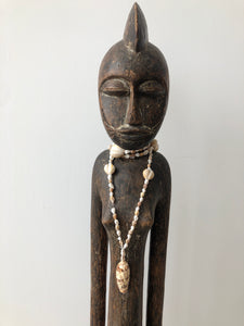 African Sculpture with Shell Necklace