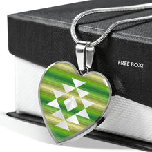 Load image into Gallery viewer, Heart Shaped Pendant With Tribal Element on Green and Tan Serape Style Background