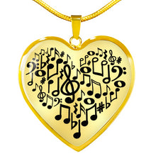 Load image into Gallery viewer, Music Notes Heart Shaped Pendant In Silver or Gold Finish