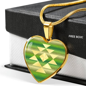 Heart Shaped Pendant With Tribal Element on Green and Tan Serape Style Background