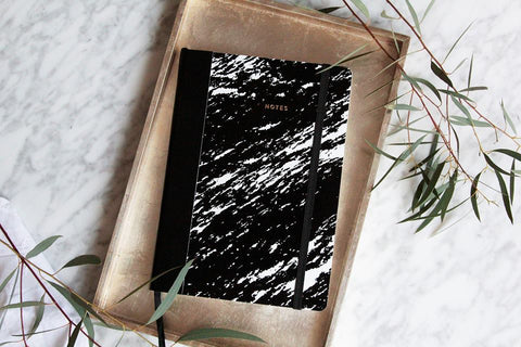 Image of Paper Love black notebook made of recycled paper by Magdalena Tekieli, available on WOMB online shop.