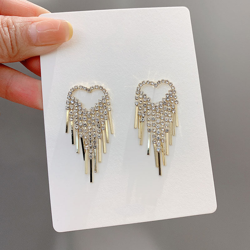 Gold love studded frill earring