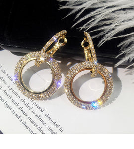 Gold and silver round diamond studs