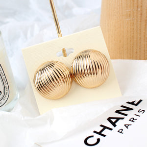 Round Shell Gold Bass Earrings