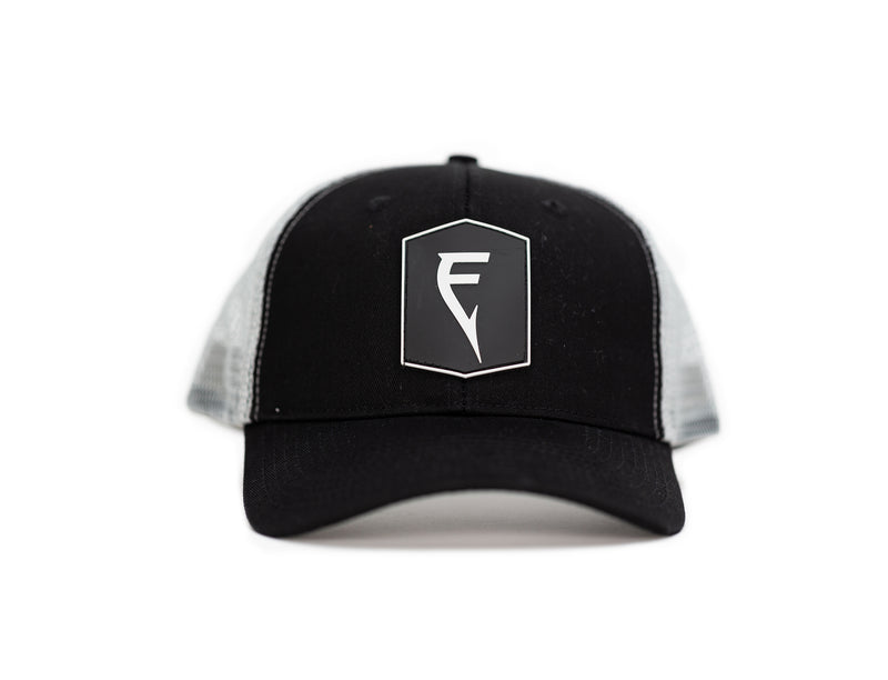 Finatic Badge Trucker in black with PVC logo patch showing in front.
