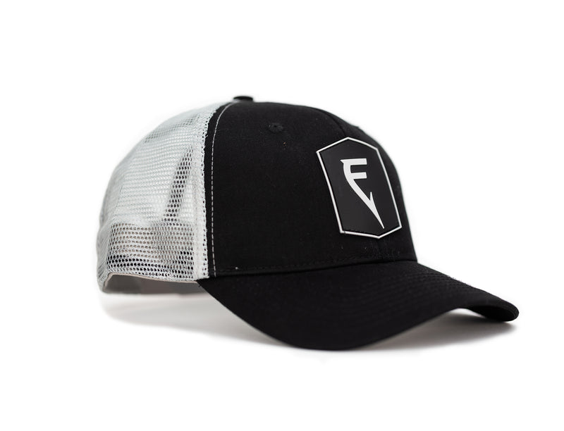 Side angle of Finatic Badge Trucker in black with PVC logo patch showing in front.