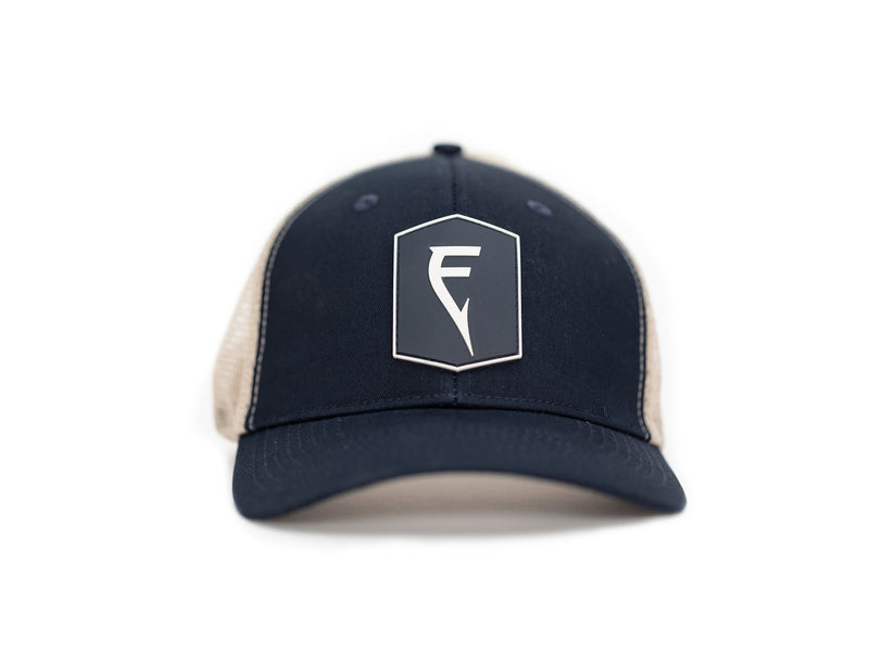 Finatic Badge Trucker in navy with PVC logo patch showing in front.
