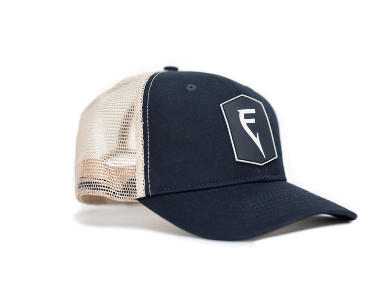 Side Angle of Finatic Badge Trucker in navy with PVC logo patch showing in front.