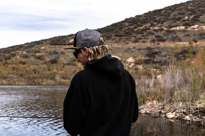 Parker Wright at Diamond Valley Lake with Finatic Tackle trucker badge flatbill hat.