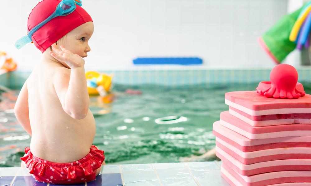 59c74b473e As daylight increases and temperatures climb, swimming with baby can be a  perfect activity to beat the summer heat. Whether you're introducing baby  to ...