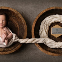 Powerful Photo of Newborn with Twin Brother's Ashes
