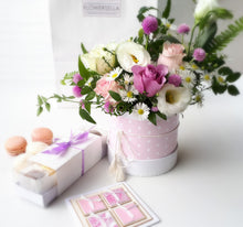 gift set of flowers and macarons