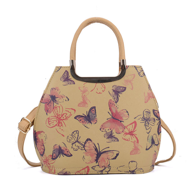 Butterfly handbag with metal accents