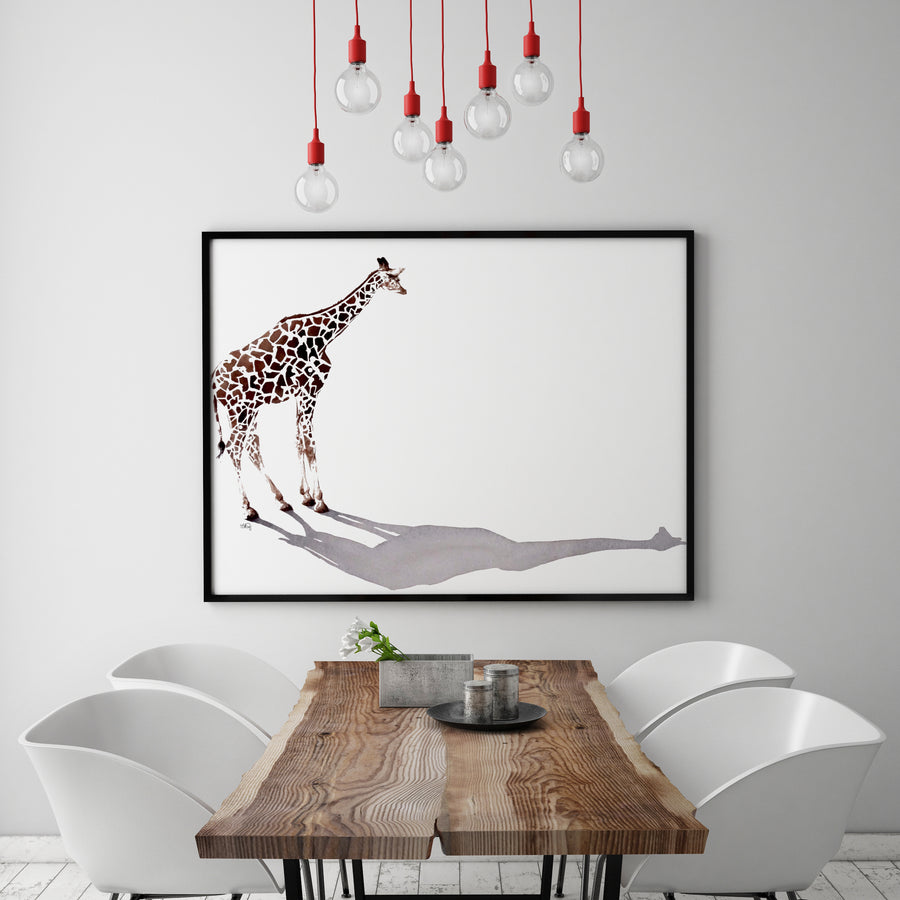 Large scale giraffe watercolour painting framed above a modern dining table.
