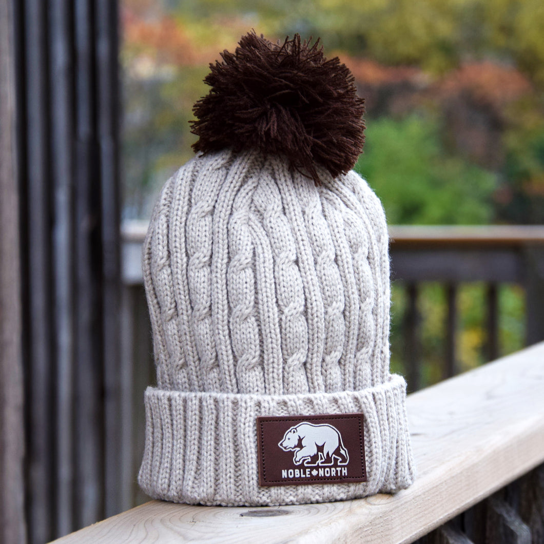 Noble North - Bear Explorer - Beige Cable Knitted Pom Toque