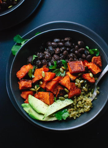An easy vegan burrito bowl dinner idea in a black pot