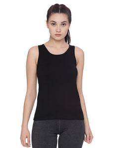 A woman wearing a fitted black organic tank top