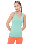 A woman wearing a teal organic workout tank top
