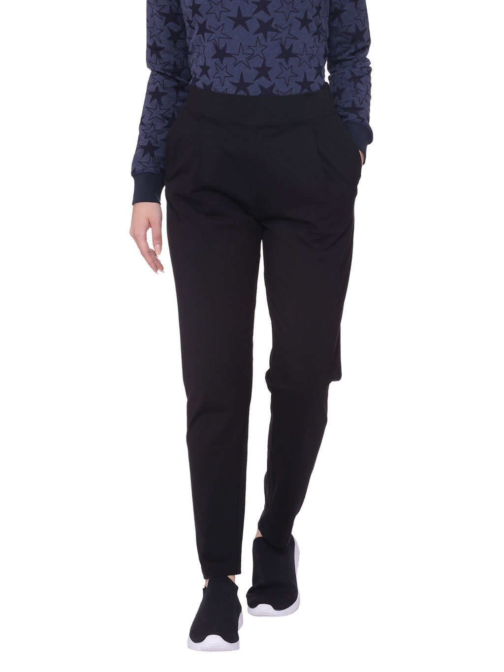 A woman wearing black organic cotton lounge pants