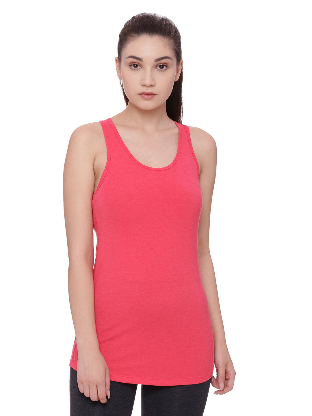 A model wearing a pink women's organic cotton tank top