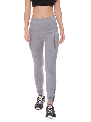 A model wearing grey high waisted leggings with zippers