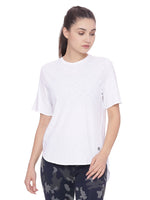 A white, loose fitting organic cotton t shirt